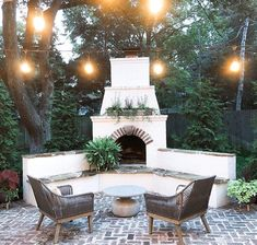 Stucco and slate outdoor fireplace with patio lights
