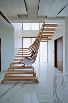 Sculptural Staircase Defines A Modern Two-Storey Apartment In Mumbai by Arquitectura En Movimiento
