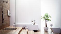 Fatua / Bagno bianco lineare in contrasto con pavimento e muro rivestito
