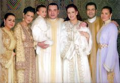 The King of Morocco, S.A.R. Mohammed VI holding the Crown Prince Moulay Al Hassan and his wife Princess Lalla Salma holding their daughter Princess Lalla Khadija (center), the king's brother Prince Moulay Al Rachid, and the King's three sisters.