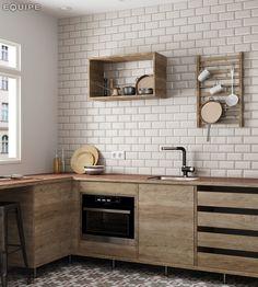 Vi elsker denne miksen av røffe tre-fronter på kjøkkenet og de klassiske Metro flisene på veggen og Caprice mønsterflisene på gulvet, begge fra Equipe #modenafliser