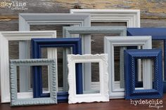 Lovely painted frames in blue, grey and white to layer on the wall above the bed.  Some old family photos would look nice in these traditional frames.