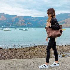 Chic & minimal style - all black outfit - black bomber jacket, ripped black skinny jeans with Adidas Superstar sneakers and Louis Vuitton Neverfull tote bag