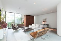 expansive architect designed living area with corten steel wall room divider and curved wall
