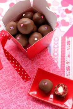 Red Velvet Cheesecake-Stuffed Cake Balls  Seriously...must try!  I love red velvet...