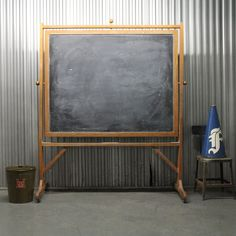 A Schoolhouse Chalkboard on wheels that looks totally vintage!! Yes, please.