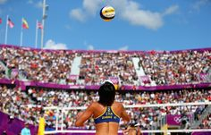 Beach Volleyball: Day 3 - Beach Volleyball Slideshows | Xi Zhang of China serves during her Women's Beach Volleyball Preliminary match with Chen Xue of China against Simone Kuhn and Nadine Zumkehr of Switzerland  (Photo: Ryan Pierse / Getty Images) #NBCOlympics