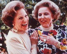 Advice columnist Ester Friedman Lederer, who wrote as Ann Landers, right, and her twin sister Pauline Friedman Phillips, who also wrote an advice column as Dear Abby, are shown in a file photo from June 1986, at their 50th high school reunion in Sioux City, Iowa. The Dear Abby author has died at 94 years old.