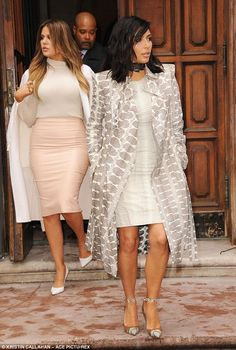 Round one: The sisters stepped out earlier on Tuesday wearing more modest attire that still clung to every curve of their voluptuous figures