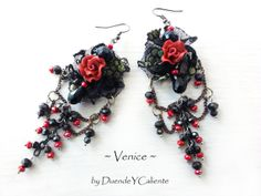 Lace earrings ~Venice~ Beautiful artistic earrings with unique design! I used upcycled black lace for the basis. The beautiful polimer clay red roses are sewn to the lace. I decorated the earrings with black and copper chains and red and black crystal beads. This mixture of colors and materials is unique and looks amazing!  OOAK earrings - I will never create exactly the same pair!