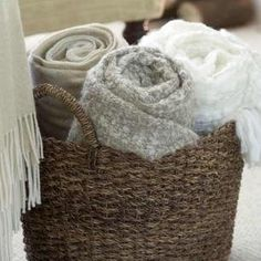 Extra blankets in basket..I really should roll them up instead of folding them.  It looks nicer!