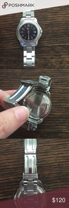 Men Swiss Army Watch See description in last picture - 100% authentic - you can take it in any department store and they should confirm- I bought it there myself for my ex - he wore it a few times so not too much wear - needs battery - accepting offers Swiss Army Accessories Watches