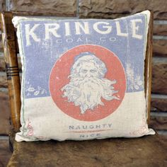 """Pillows are an easy way to change up your sofa or chair to make it seasonally fresh! Add a touch of holiday cheer and whimsy to your farmhouse decor! Kringle Coal Pillow Front and back designs Old feedsack look material Pillow comes pre-filled 65% cotton, 35% linen 100% polyester fiber fill Care instructions: Wipe clean w/ a damp cloth 12"""" x 12"""" square"""