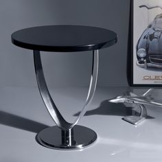 Chicago, side table.Glossy black lacquered top and stainless steel base.  Designed By: GAMA ~Georges Amatoury. To be ordered online through www.levantania.com