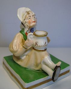 Staffordshire porcelain inkwell figure