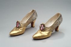 Gold shoes with rhinestone buckles  Date Made  1928  Description  Gold with rhinestone buckles. Worn in 1928 by Matilda Dodge Wilson when posing for portraitist Louis Betts. Finished portrait hangs in Dining Room of Meadow Brook Hall.