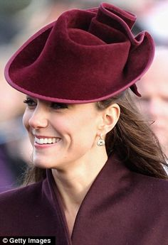 At her first Royal Christmas the Duchess of Cambridge looked elegant in a simple maroon outfit by a British designer