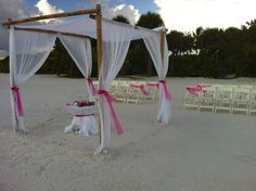A elegant addition to any beach ceremony; our elegant canopy with you choice of accent color to coordinate with you sand unity table and chair sashes....  Our elegant wedding packages.  Created by Simple Elegant Weddings