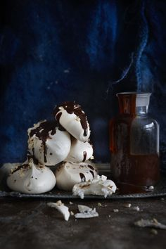 Hazelnut meringues with rich chocolate sauce (try with dark chocolate ice cream)