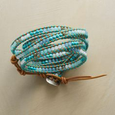"""HENNA SKY 5 WRAP BRACELET--Laced to tawny leather with teal thread, Chan Luu's sequenced stones encircle the wrist with white jade, labradorite, turquoise and two shades of tinted quartz. Handmade with sterling silver button clasp. 32""""to 34""""L."""