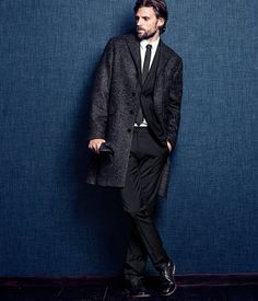 Suit pants in a stretch wool blend with side pockets and back welt pockets with button. Half-lined.