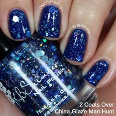 I-Got-A-Crush-On-Blue by KBShimmer. A royal blue jelly, this polish was born to add sparkle and shine to your nails.   Holographic glitters ranging from micro to extra large in size capture the light  to reflect a rainbow of colors.  When applied in three thin layers, the  glitters seem to float in a see of blue jelly, something that camera has a hard  time capturing. This polish also looks stunning when layered over black or navy blue.
