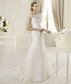 Manuel Mota simple wedding dress lace neckline  Not like I'm getting married, again ever, but wow what a beautiful dress!!