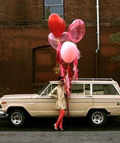 love balloons....tying Valentine balloons to someones car!!!! Lol