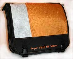 Wow! Soyuz Parachute laptop bag: Recycled from space! This bag was made using a piece of the re-entry parachute from the Soyuz TM-8 mission.  Flown in space to the Mir space station from 9/5/09 to 2/19/90.