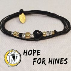Thread: BlackHeart: Black GlassGlass Beads: Gold, Silver Lined Crystal, BlackTag: NTIO (brass)Size: Fits AllClose-up Photo: Not Actual SizeAll About Hines:Hines David Rotriga, age 2, was diagnosed with stage IV neuroblastoma on December 26, 2013. He is the son of Kevin and Debbie Bringman Rotriga.DescriptionHines David was born September 9th 2011. His parents are Kevin