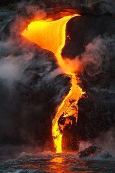 Lava flow - Hawaii, the Big Island. Lava flows into the sea.
