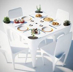 Outdoor dining table with wind-resistant plate-recesses - just right for the wind in Cape Town