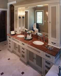 Granite with dual sinks and side lighting. Lots of storage!