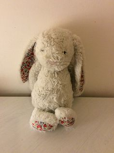Trying to find a girl who lost her bunny. Please help. It is a white Jellycat bunny with flowers in its ears. Lost on Friday 11th March, on a train in Cambridge, England.