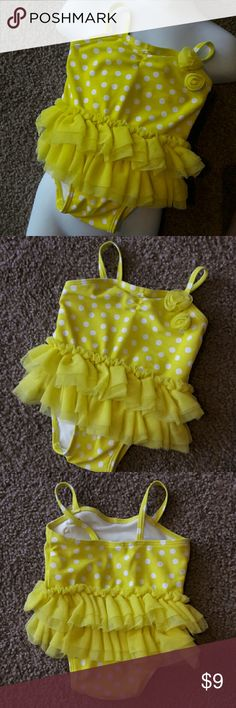 ? Polka Dot tutu Baby One Piece Swimsuit  Old Navy Used once. In great condition. Polka Dot tutu Baby One Piece Swimsuit 0-3 Month Old Navy yellow and white. Old Navy Swim One Piece