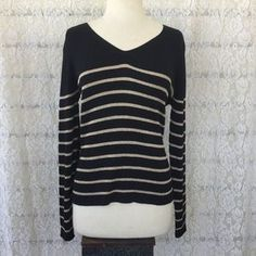 I just discovered this while shopping on Poshmark: NWT BLACK AND GOLD SWEATER…