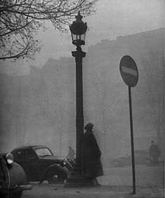 Yale Joel - People and vehicles moving about city shrouded in fog, Paris, 1948 From LIFE Images