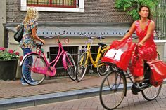Emancipated Amsterdam: Where women ride in Skirts, Heels and paint our bikes any dang color we want! #Amsterdam