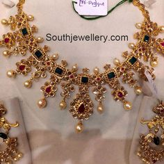 22 carat gold elaborate pacchi necklace set studded with uncut polki diamonds, emeralalds, rubies and south sea pearls from Premraj jewellers. For price inquiries contact on Whatsapp: 97 00 009000 Gold Earrings Designs, Gold Jewellery Design, Gold Jewelry, Jewelry Sets, Jewelry Making, Indian Wedding Jewelry, Bridal Jewelry, India Jewelry, Latest Jewellery