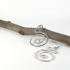 Dangle aluminium earrings with spiral. Wire wrapped woman earrings