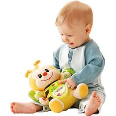 Delight your baby with the VTech Touch and Learn Musical Bee. This tuneful stuffed animal teaches basic numbers shapes and colors. The bee is made of yellow plush with black stripes. He has bright sh...