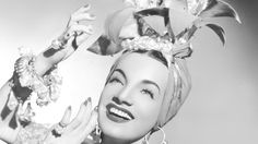 Carmen Miranda, 46, the explosive Brazilian star who set the hips of the nation swinging to the samba, was found dead yesterday in a hallway of her palatial home at 616 N. Bedford Drive, Beverly Hills.  Dr. W.L. Marxer, her physician, said she was a victim of a heart attack.  The tiny actress, famed for her huge, fruit-salad hats and her high platform shoes, had completed the filming of a television comedy with Jimmy Durante late Thursday night.