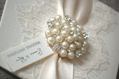 A truly luxurious collection, perfect for brides who have their heart set on a Wedding themed around romantic, vintage lace. With their stunning crystal and pearl brooch set against a beautiful background of satin and fine eyelash lace, the Ballet invitations are simply stunning. One thing is guaranteed - wedding stationery does not come prettier than this!