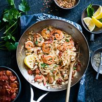 Homemade fresh pasta recipe with shrimp scampi. This easy shrimp scampi pasta recipe is quick Italian recipe made with fresh fettuccini and scampi sauce