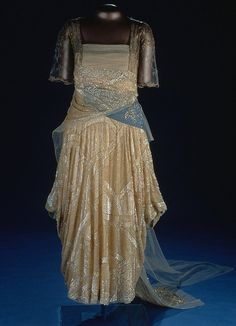 Florence Harding's Dress    Florence Harding's dress features pearlized sequins on tulle and rhinestone-trimmed blue velvet ribbon. It was designed by Harry Collins.
