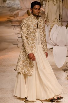 Rohit Bal for Tafsir- how about regular pajama with that..Sherwani design is nice.