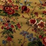 Bastide Fabric in Brown Floral is a colorful, patterned cotton/linen blend upholstery fabric, drapery, or bedding and pillow fabric. Neutral and pretty, this classic floral print has bursts of roses, blue bells, and hibiscus flowers in shades of pink, red, green, and blue, all on a brown, burlap shaded background.