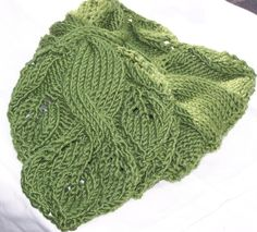 The Twisted Vine Neckwarmer is a fun and interesting KNITTING PATTER which combines my favorite pattern feature - lace and cables. The swooping large cable is bordered by cascading leaves which entwine until the edge. This scarf can be knit in any yarn from fingering to worsted weight.