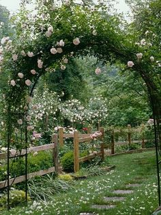 Rose arbor with split rail fence and stepping stones. Gorgeous