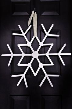Hanging Craft Stick Snowflake: For those who love glitter! Check out this super cute and super easy holiday craft for the front door. This giant glitter-covered snowflake — made with wooden craft sticks, glue and some paint — doesn't have to live outside. We think this snowflake would look great in any room of the house! Source: The Ballard Bunch